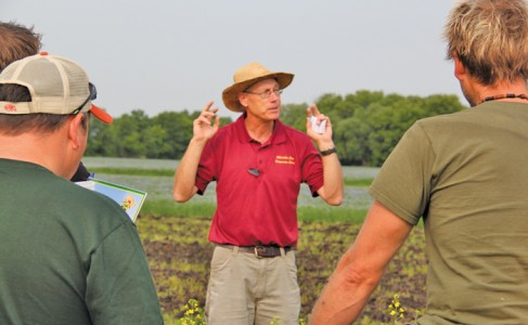 John Heard (centre) of Manitoba Agriculture, Food and Rural Development says the 2014 Crop Diagnostic School, which was sold out this year, keeps evolving to agronomists' needs.  photo: allan dawson