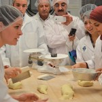 International guests learn how to make durum bread.