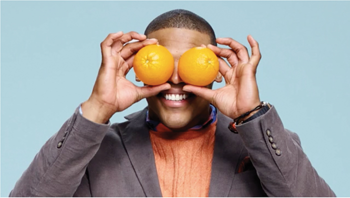 man with oranges in front of his eyes