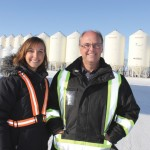 father and daughter farmers wearing safety vests