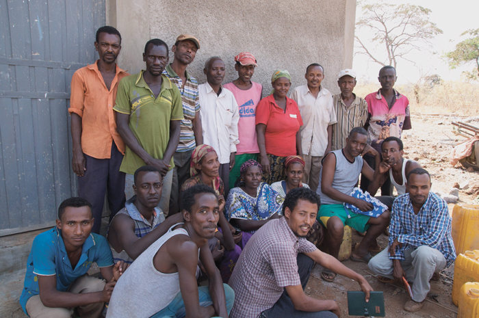 Members of the Sirba Abay irrigation users' group gather in the shade of their new farmers' training centre to discuss how irrigation has improved their incomes and nutrition.