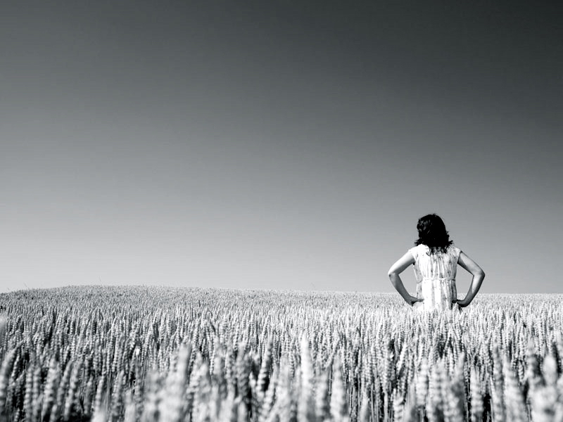 woman standing in a wheat field
