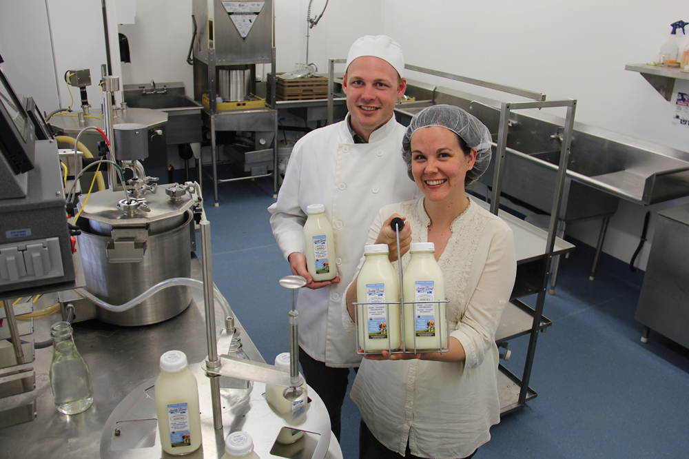 man and woman in dairy facility