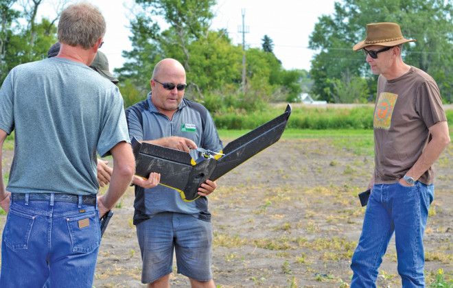Jeffery Kostuik (centre), diversification specialist with Parkland Crop Diversification Foundation, demonstrated his SenseFly eBee fixed-wing drone at the Westman Agriculture Diversification Organization's (WADO) field day in Melita on July 21.