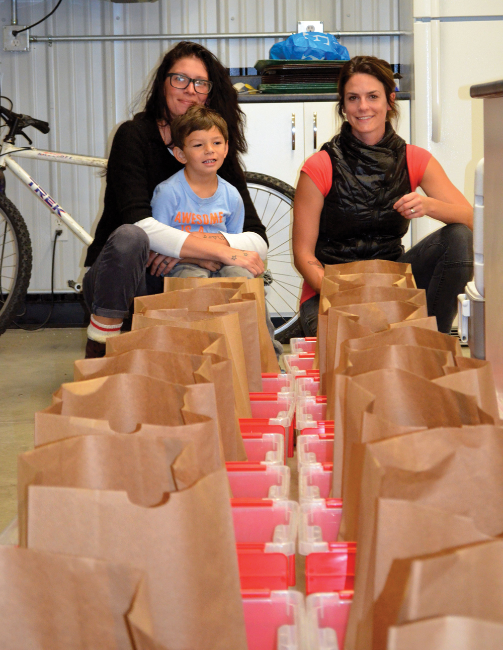 Erin Gobeil (l) with her son, Kal-El and Nikki Dean (r) have volunteered to help run the Good Food Box pilot project.