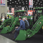 Visitors check out Deere equipment at the National Farm Machinery show in Louisville, Kentucky on Feb. 11. With U.S. farmers bracing for a third year of declining incomes, many have said 