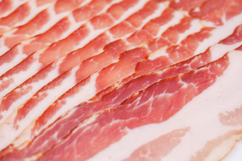 Fresh raw bacon slices close up image