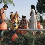 Residents wait to fill their containers with water in a field in Latur, India, April 17, 2016.