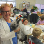 Elaine Owen, Grade 6 teacher at Miami School, holds the classroom's pet angora rabbit that spends his 