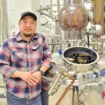 Jason Kang, master distiller at Capital K Distillery, stands in front of the network of stills at his location in Winnipeg.