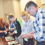 Delegates try out the recently released Weedscout app during the Global 4-H Summit in Ottawa July 11-14.