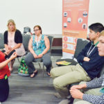 Delegates discuss soil health issues, solutions and what should be included in a hypothetical soil health kit during a breakout session of the Global 4-H Summit.