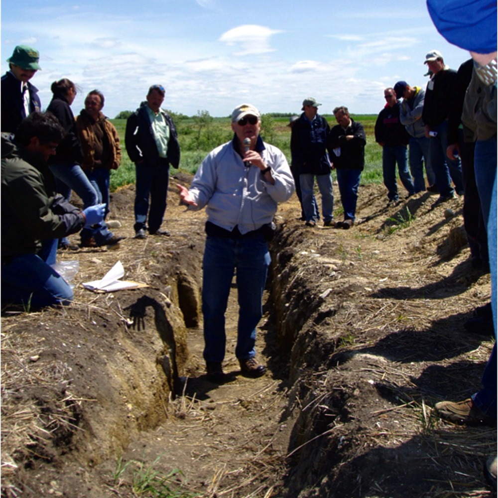 Dr. Alan Moulin takes tour attendees through the field.