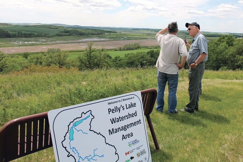 Manitoba's Pelly Lake water-control project is cited as one example of how natural features can control flooding more cheaply than engineered structures.