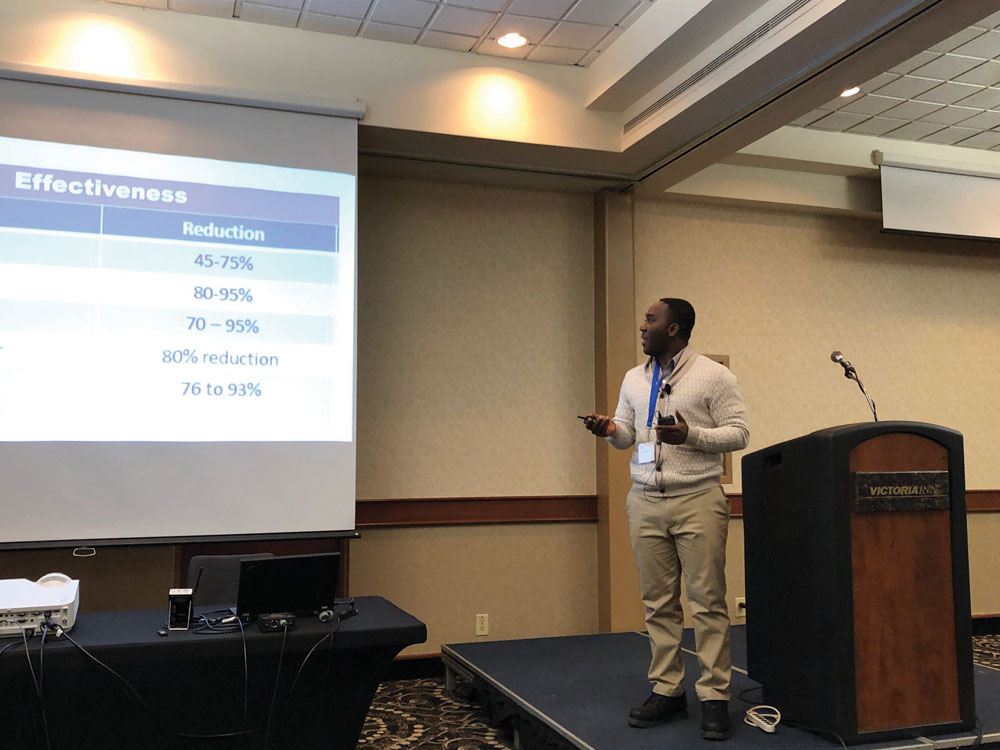 Desmond Essien speaking at the New and Emerging Research session on December 12 at the Prairie Livestock Expo in Winnipeg.