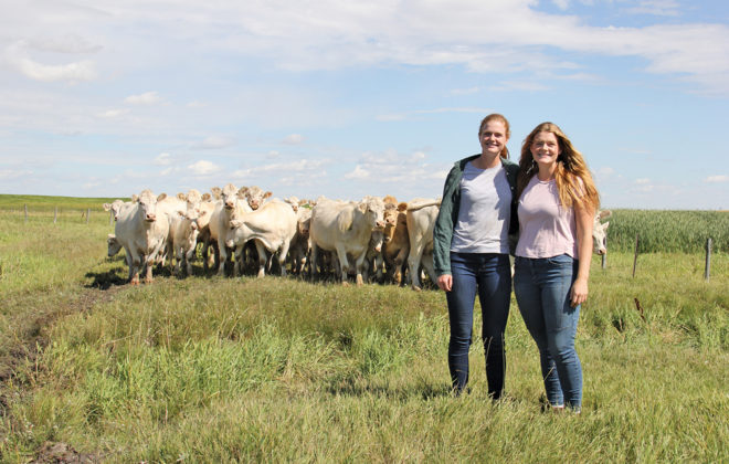 Clare (left) and Jill (right) Martens farm cattle and seed crops with their dad and uncle near Boissevain.