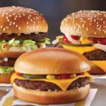 A sampling of the burger options (Big Mac, cheeseburger and Quarter Pounder) available from McDonald's Canada.