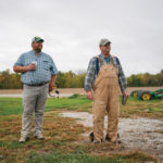 Paul Hodgen (l) and his father Abe stand on their farm in Roachdale, Indiana.