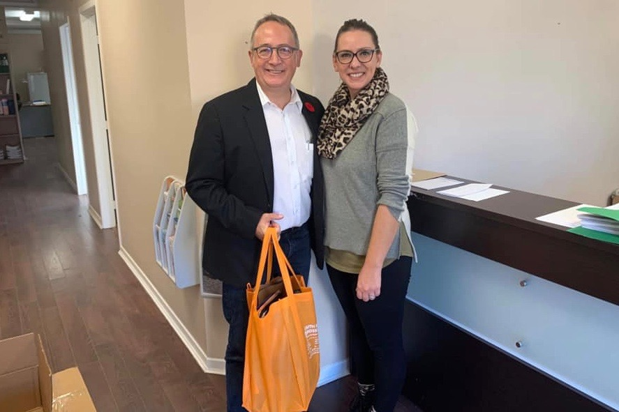 In a photo posted Nov. 6, incoming Berthier-Maskinonge MP Yves Perron meets with the riding's outgoing NDP MP Ruth Ellen Brosseau to pick up active files from her constituency office. (Facebook)