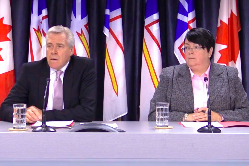 "Newfoundland and Labrador Premier Dwight Ball and Finance Minister Cathy Bennett lay out the ""Flatter, Leaner Management Structure"" on Feb. 22. (Gov.NL.ca)"