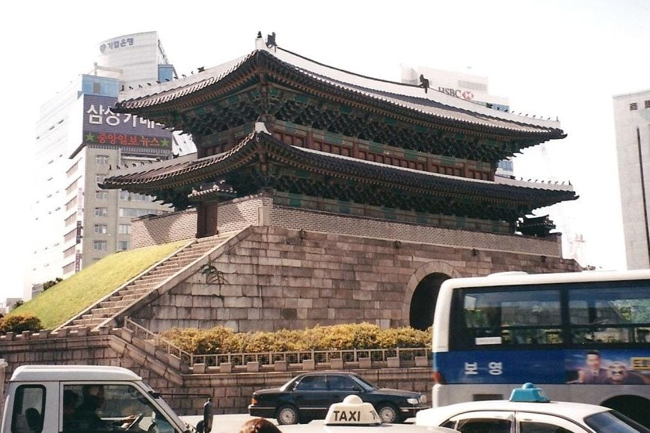 """Namdaemun, the """"Great Southern Gate"""" in the walls that once surrounded the city of Seoul. This photo was taken before a 2008 fire damaged the gate's wooden structure, which was restored by May 2013. (CIA.gov)"""