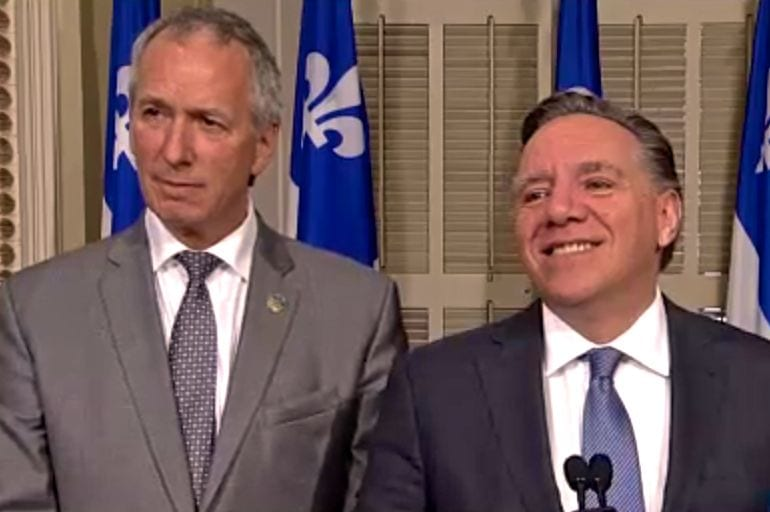Andre Lamontagne, shown here at left at a press conference in May 2017 with CAQ leader Francois Legault, is Quebec's new agriculture minister. (Video screengrab from AssNat.qc.ca)