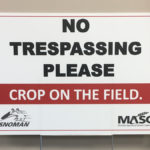 Signage to protect unharvested crops from snowmobiles