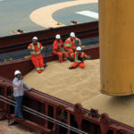 Employees at the Tiplam terminal in Santos, Brazil load soybeans on a cargo ship bound for China on March 13, 2017.
