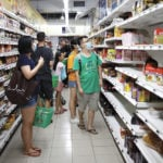 Consumers stock up at a Singapore supermarket on Feb. 7, 2020 after the state raised its coronavirus outbreak alert to orange.