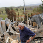 Farmer Jeff McCole, 70, pauses in front of his family home destroyed by bushfire in Buchan, Victoria, Australia, Jan. 23, 2020.