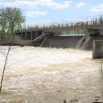 Spring runoff flows through a control structure on the Assiniboine River near Portage la Prairie, Man. in 2014. (MarketsFarm photo by Glen Hallick)