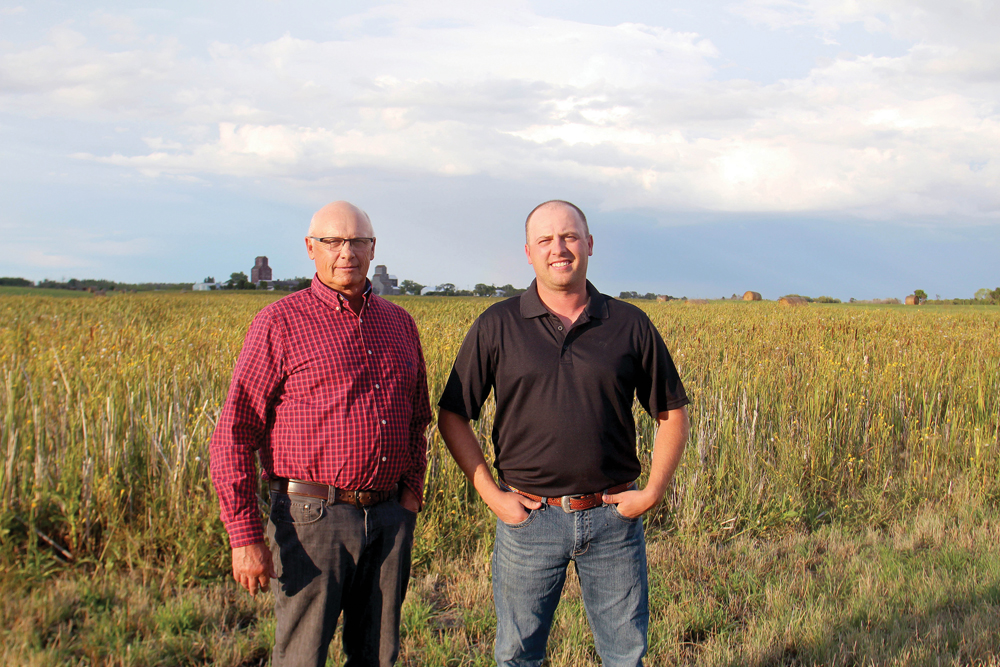 Brian (left) and Andy Sterling say the native prairie restoration along the Jackson Creek was a longtime family dream.