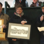 Cam and Myrna Schweitzer, from left, accepted the award from Blair McRae, Canadian Simmental Association representative.