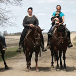 Members of the McIntyre clan, Lacey, Shane, Kelly, Pam with Dayce, and Kayla, from left, enjoy horses, along with the horse operation founders Randy and Pat.