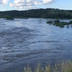 Dozens evacuated as floodwaters test Rivers dam