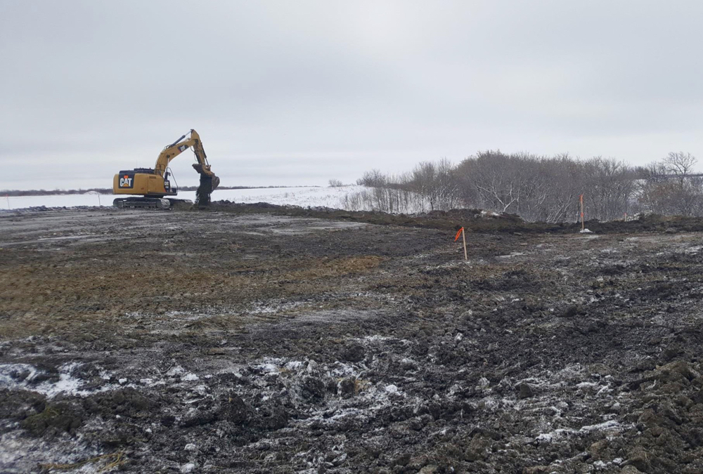 Construction of a dam and water retention project at Swan Lake First Nation.