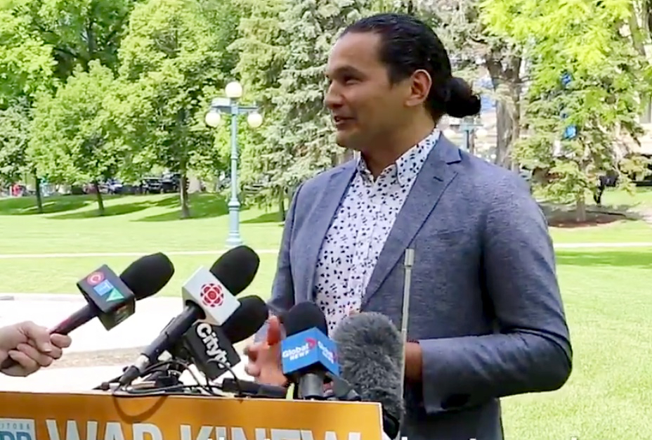 NDP leader Wab Kinew, seen here addressing reporters on June 30, says the PC government didn't do enough to help Manitoba farmers on a carbon tax exemption for grain drying.