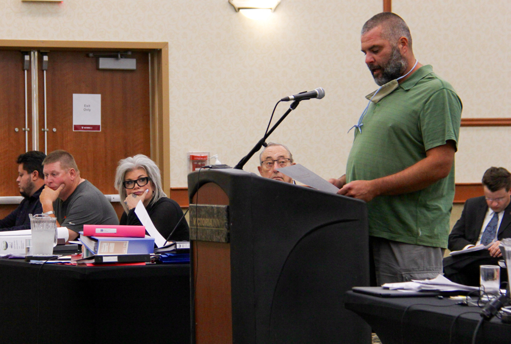 Rosser resident Dave Kaplen speaks on the second day of the hearing, July 28.