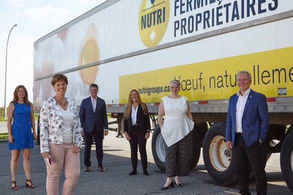 Officials at the Aug. 13, 2020 rollout of the federal surplus food program included (l-r) Julie Marchand of Food Banks of Quebec, Agriculture Minister Marie-Claude Bibeau, Claude Dulude of Nutri Group, Marie-Jose Mastromonaco of Second Harvest, Tania Little of Food Banks Canada and Serge Lefebvre of Nutri Group. (Photo courtesy Agriculture and Agri-Food Canada)