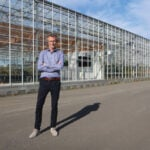 Bjorn Orvar, co-founder and chief scientific officer at ORF Genetics, poses for a photo outside the company's greenhouse in southwest Iceland.