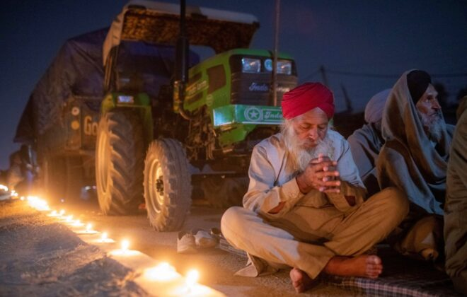 A farmer prays to mark the 551st birth anniversary of Guru Nanak Dev, the first Sikh Guru and founder of Sikh faith, at Singhu border near Delhi on Nov. 30, 2020, at the site of a protest against newly passed farm bills. (Photo: Reuters/Danish Siddiqui)