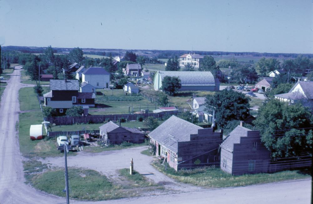 This aerial photo from the early 1960s shows the consolidated school in the field behind the village of Basswood.