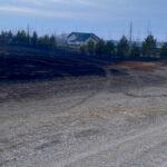 A home narrowly escapes a grassfire near Carberry April 1.