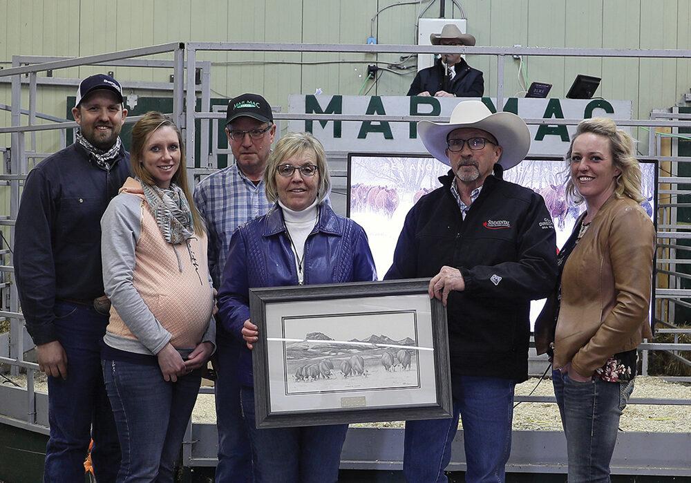 The McRae family accepts the 2020 A.O. Henuset Ambassador Award. From (l to r): Brett, Chantel, Blair and Lois McRae, Bill Biglieni and Melissa McRae.